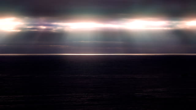 Storm and rays of lights over the sea