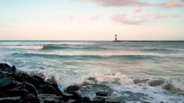 storm at the baltic sea in rostock warnemünde slow motion - küstenlandschaft stock-videos und b-roll-filmmaterial
