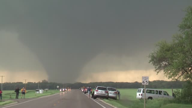 Storm chasers approach a large tornado in Bennington KS