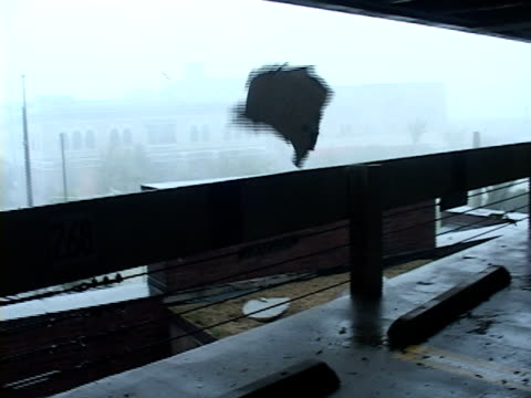 storm chasers rush to take cover as lethal flying debris narrowly misses them as hurricane katrina makes land fall along the mississippi gulf coast... - hurricane katrina stock videos and b-roll footage