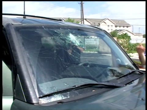 storm chasers survey hailstorm damage to car, usa - damaged stock videos & royalty-free footage