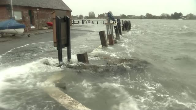 storm ciara causes flooding in the calder valley and north wales; england: west sussex: bosham: waves crashing over flood walls onto dock duck... - west sussex stock videos & royalty-free footage