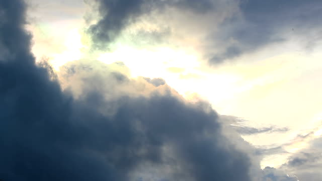 Storm Cloud against Sun beam rainbow cloudscape time-lapse