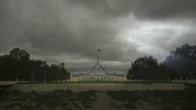 storm clouds above parliament house, australia - australian politics stock videos & royalty-free footage