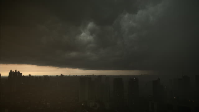 storm clouds and lightning over jakarta - 30 seconds or greater stock-videos und b-roll-filmmaterial
