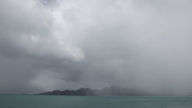 storm clouds and rain over sea and mountains - insel south georgia island stock-videos und b-roll-filmmaterial