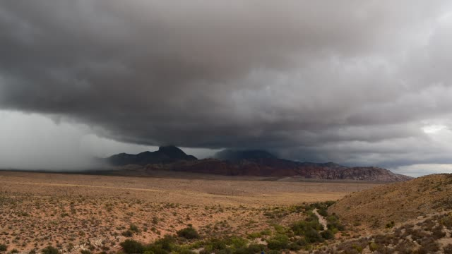 storm clouds appear at the red rock canyon national conservation area on august 25, 2013 near las vegas, nevada. moisture from tropical storm ivo is... - nevada stock videos & royalty-free footage