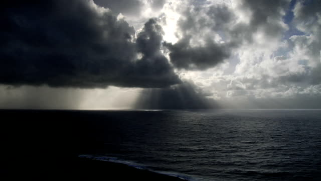 storm clouds approach over ocean - time lapse - ominous stock videos & royalty-free footage