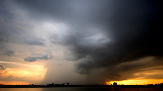 storm clouds at sunset timelapse - monsoon stock videos & royalty-free footage