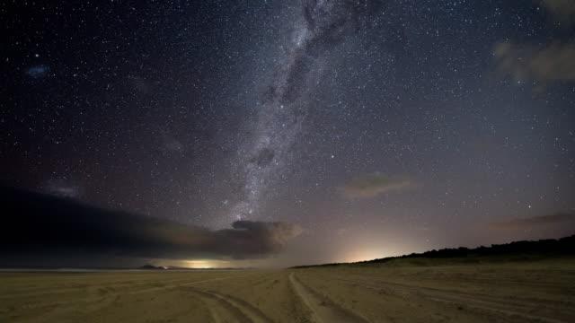 storm clouds clearing to reveal milky way galaxy - rymd och astronomi bildbanksvideor och videomaterial från bakom kulisserna