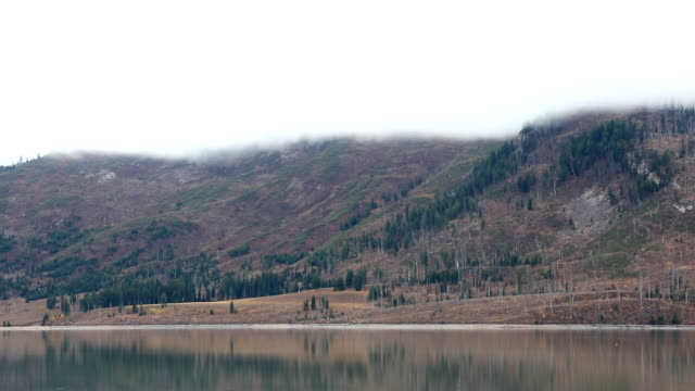 storm clouds covering mountain tops and lake - grand teton stock videos & royalty-free footage