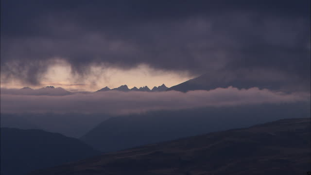 storm clouds drift above mountains in peru. - storm cloud stock videos & royalty-free footage