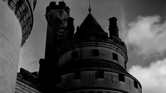 storm clouds drift above the towering spires of chateau de pierrefonds in france. - 1937 stock videos & royalty-free footage