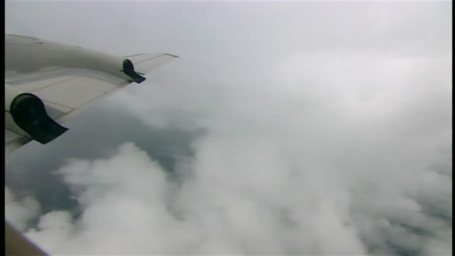 of storm clouds from window of c-130 - storm cloud stock videos & royalty-free footage