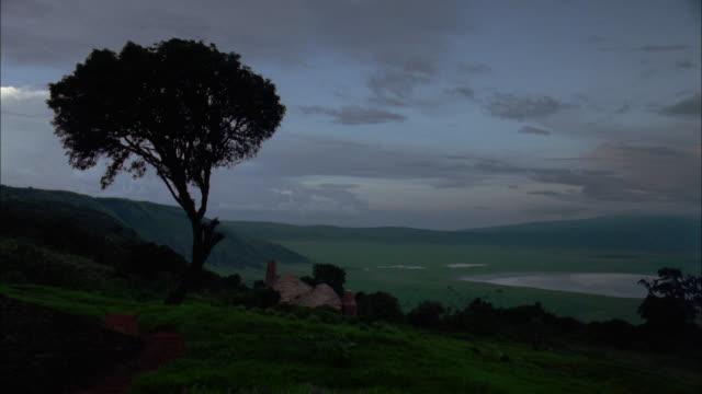 vidéos et rushes de storm clouds gather above a green valley. available in hd. - ciel menaçant