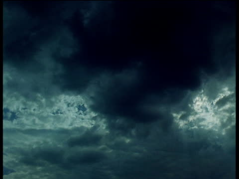 Storm clouds gather in sunburst sky