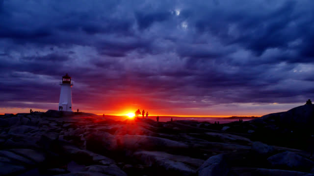 storm clouds gather over peggy's cove lighthouse - nova scotia stock videos and b-roll footage