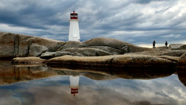 storm clouds gather over peggy's cove lighthouse - nova scotia stock videos & royalty-free footage