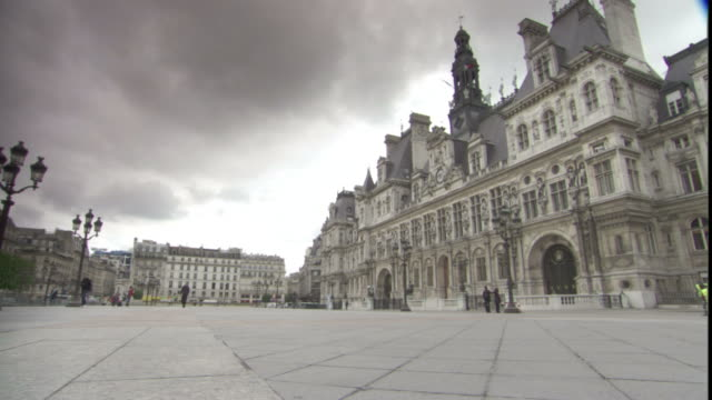 storm clouds gather over the hotel de ville in paris. - hotel de ville paris stock videos & royalty-free footage