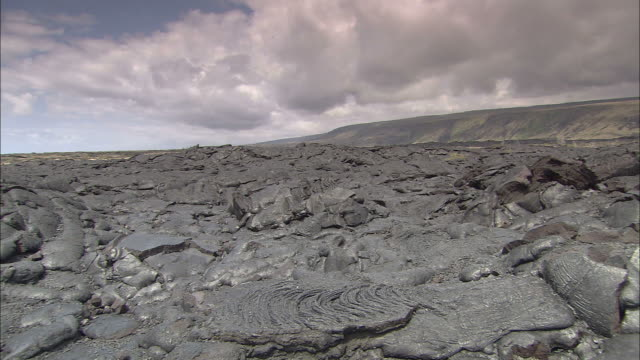 storm clouds hang over a field of hardened lava. - no parking sign stock videos & royalty-free footage