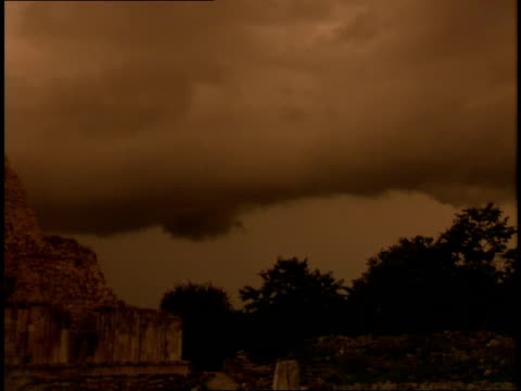 storm clouds loom above a mayan pyramid. - mayan stock videos & royalty-free footage