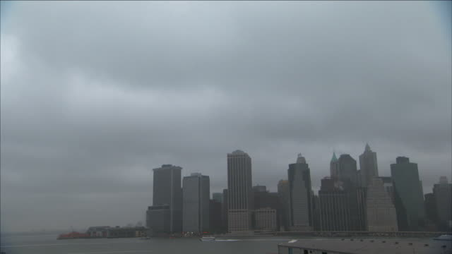 storm clouds loom above manhattan. - manhattan video stock e b–roll