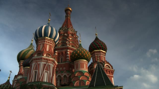 storm clouds loom over st. basil's cathedral in moscow's red square. available in hd. - st. basil's cathedral stock videos and b-roll footage