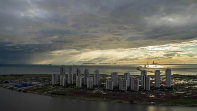 storm clouds movement over land mark city apartment complex and incheon bridge / songdo ibd, yeonsu-gu, incheon, south korea - overcast stock videos & royalty-free footage