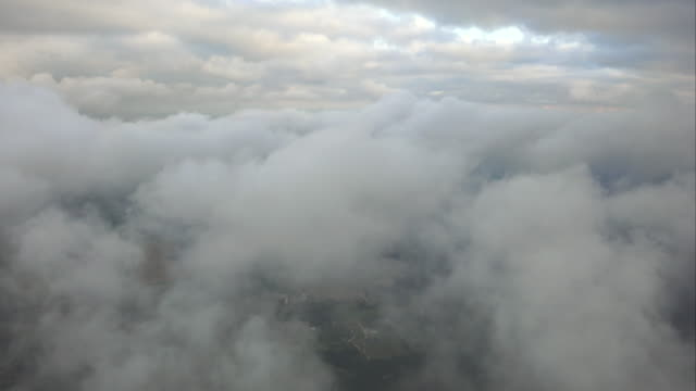 WS AERIAL POV Storm clouds moving in sky with landscape