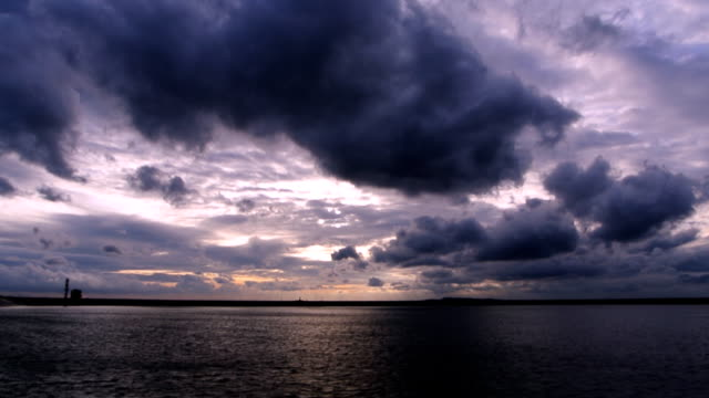storm clouds moving time lapse over the lake - dramatic sky stock videos & royalty-free footage