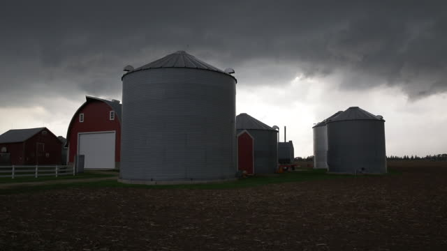 storm clouds over a diary farm in wisconsin - wisconsin video stock e b–roll