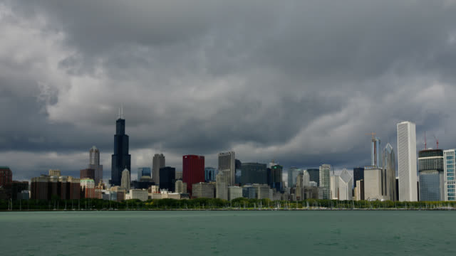 time lapse wide shot storm clouds over chicago skyline and waterfront, illinois - one prudential plaza stock videos & royalty-free footage