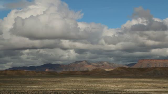storm clouds over desert book cliffs time lapse colorado plateau utah - colorado plateau stock videos & royalty-free footage