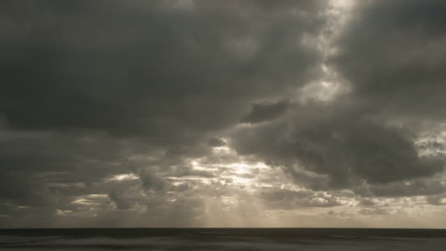 storm clouds over ocean - stimmungsvoller himmel stock-videos und b-roll-filmmaterial