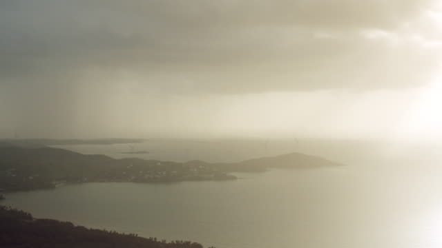 ws aerial pov storm clouds over punta lima / naguabo, puerto rico, united states - coastal feature stock videos & royalty-free footage