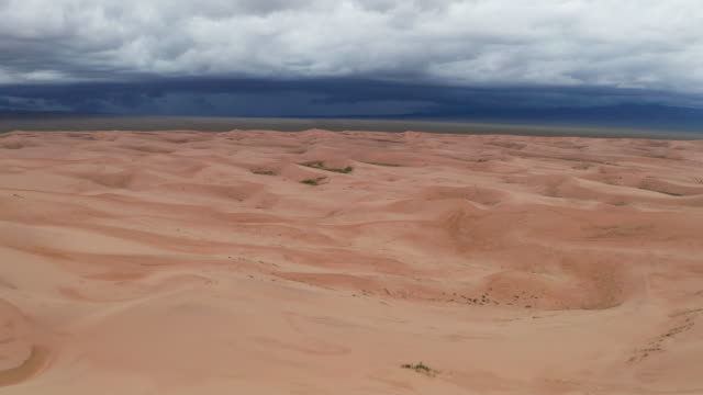 storm clouds over sand dunes in the desert. - sand dune stock videos & royalty-free footage