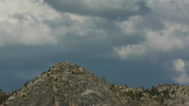 tl storm clouds over wilderness mountain peak, yosemite national park, california - californian sierra nevada stock videos and b-roll footage