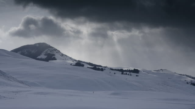 storm clouds pass over snow covered landscape. - yellowstone national park stock videos & royalty-free footage