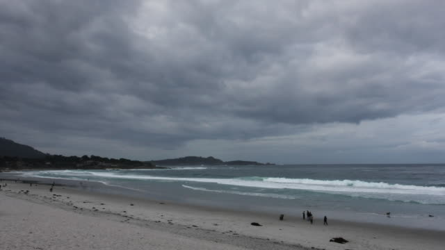 storm clouds roll above a sandy beach in carmel, california. - carmel california stock videos & royalty-free footage