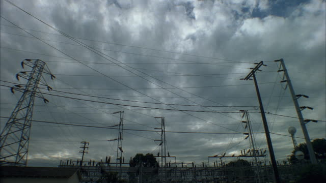 T/L WS Storm clouds rolling above electrical substation, Santa Barbara, California, USA