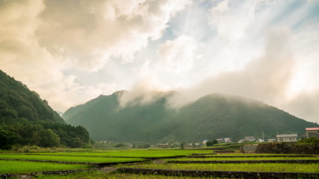 storm clouds rolling over a mountain - rice paddy stock videos & royalty-free footage