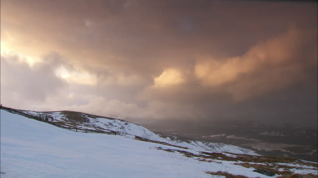 storm clouds slowly pass over aonach mor.  - 30 seconds or greater stock videos & royalty-free footage