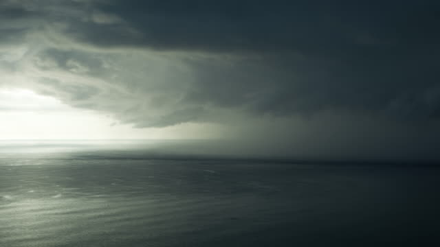 storm coming in from east over ocean - storm cloud stock-videos und b-roll-filmmaterial