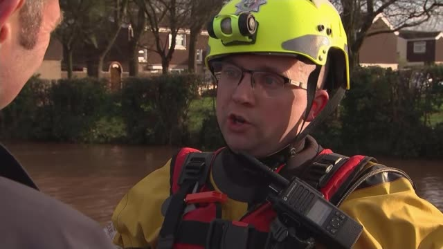 flood warnings in place across uk as flooding causes widespread devastation; england: herefordshire: hereford: ext fire & rescue service personnel... - herefordshire stock videos & royalty-free footage