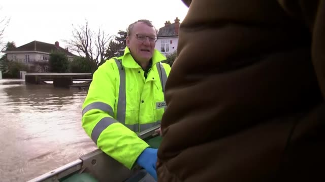 flood warnings in place across uk as flooding causes widespread devastation; england: herefordshire: hereford: ext flood wardens pulling boat through... - herefordshire stock videos & royalty-free footage