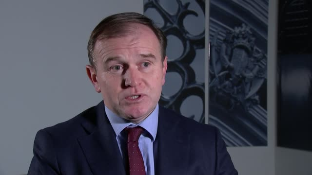 flood warnings in place across uk as flooding causes widespread devastation; england: london: int george eustice mp interview sot york: ext gv woman... - surrounding wall点の映像素材/bロール