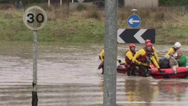 storm dennis brings flooding to many areas wales wales nantgarw flooded street and car standing in floodwater / firefighters pulling boat carrying... - wales stock videos & royalty-free footage