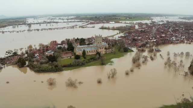 flooded communities expecting more heavy rain; england: herefordshire: ext air views / drone footage church on island surrounded by flooded landscape... - herefordshire bildbanksvideor och videomaterial från bakom kulisserna