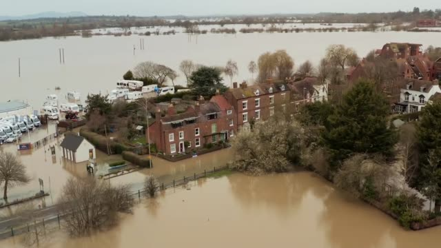 flooded communities expecting more heavy rain; england: herefordshire: ext air views / drone footage flooded landscape - herefordshire stock videos & royalty-free footage