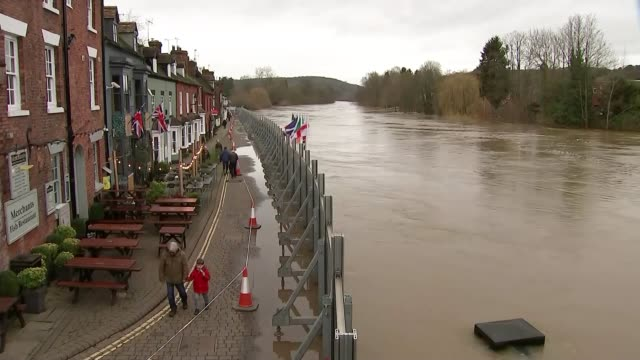 flooded communities expecting more heavy rain; england: herefordshire: ext anthony perry interview sot high angle view flood defences and swollen... - herefordshire stock videos & royalty-free footage